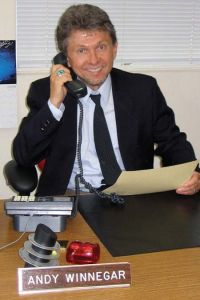 a handsome businessman wearing a necktie talking on the phone